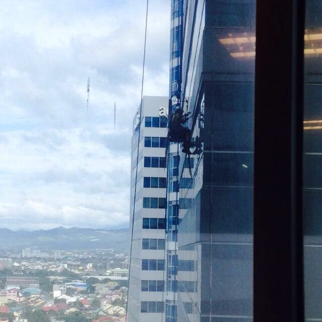 window cleaner in one of the buildings in Eastwood